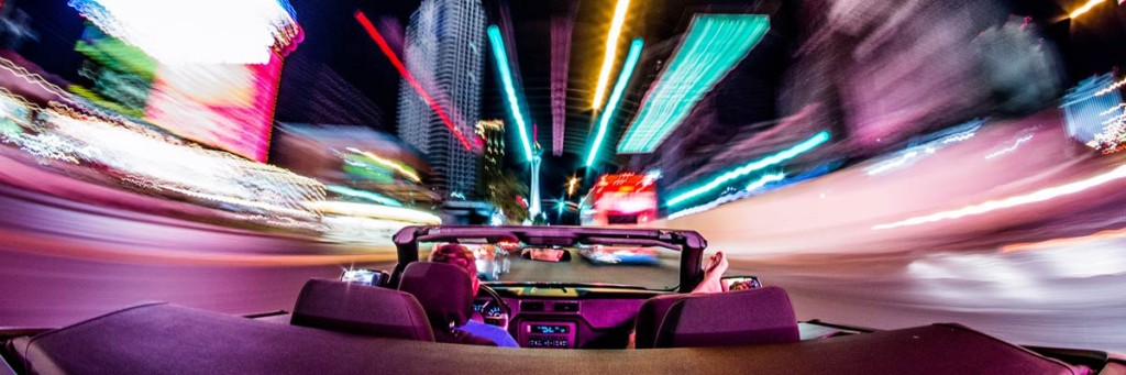 driving the strip at night in a convertible