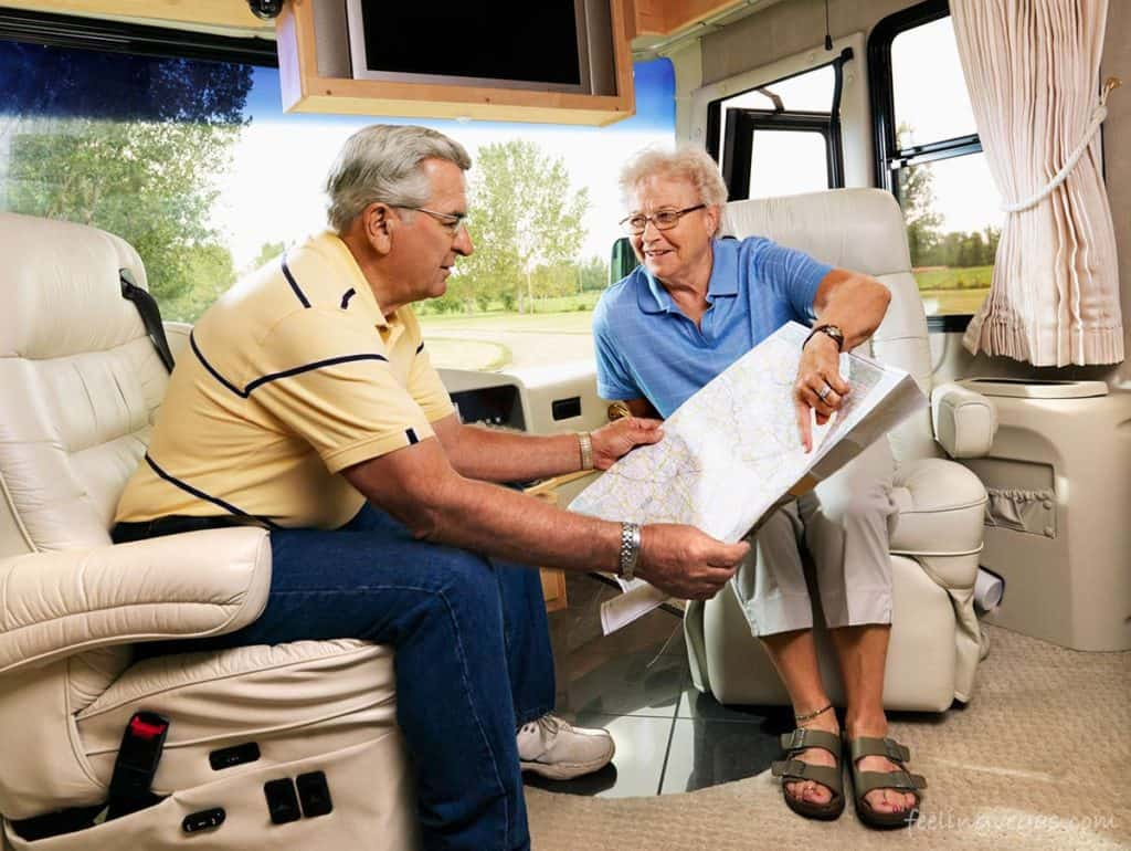 couple looking at map in rv