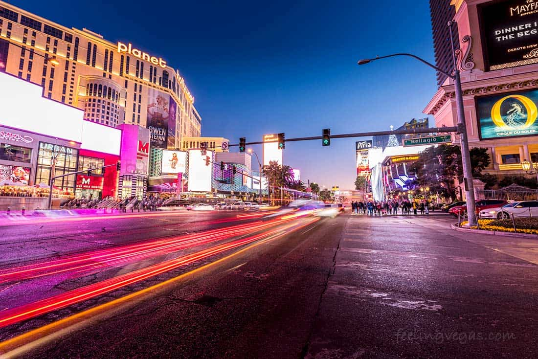 The Las Vegas Strip with traffic and pedestrians at night
