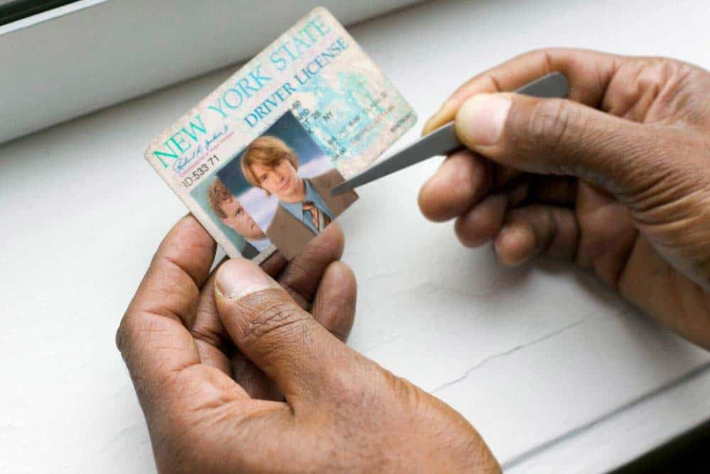 Fake id being made out of an old  drivers license.