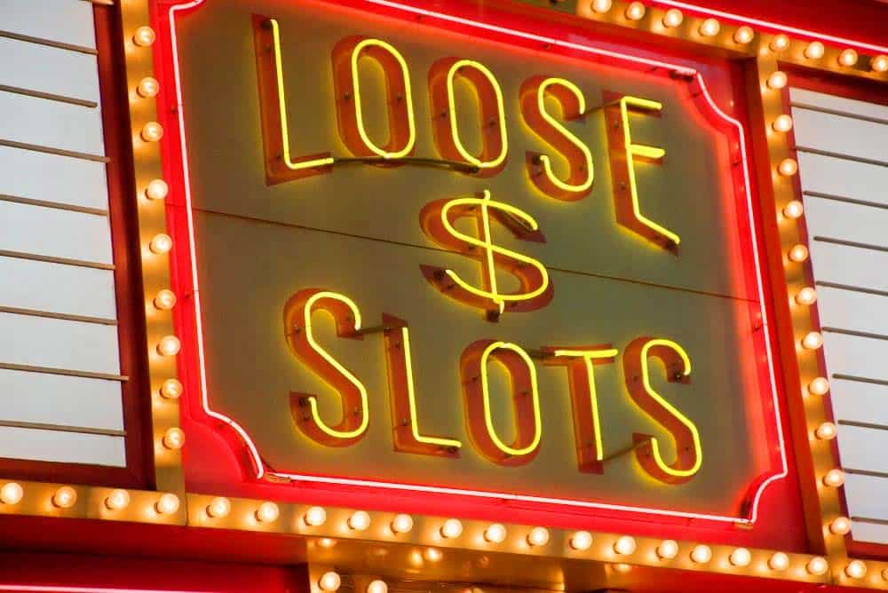 Neon sign indicating loose slot machines in vegas