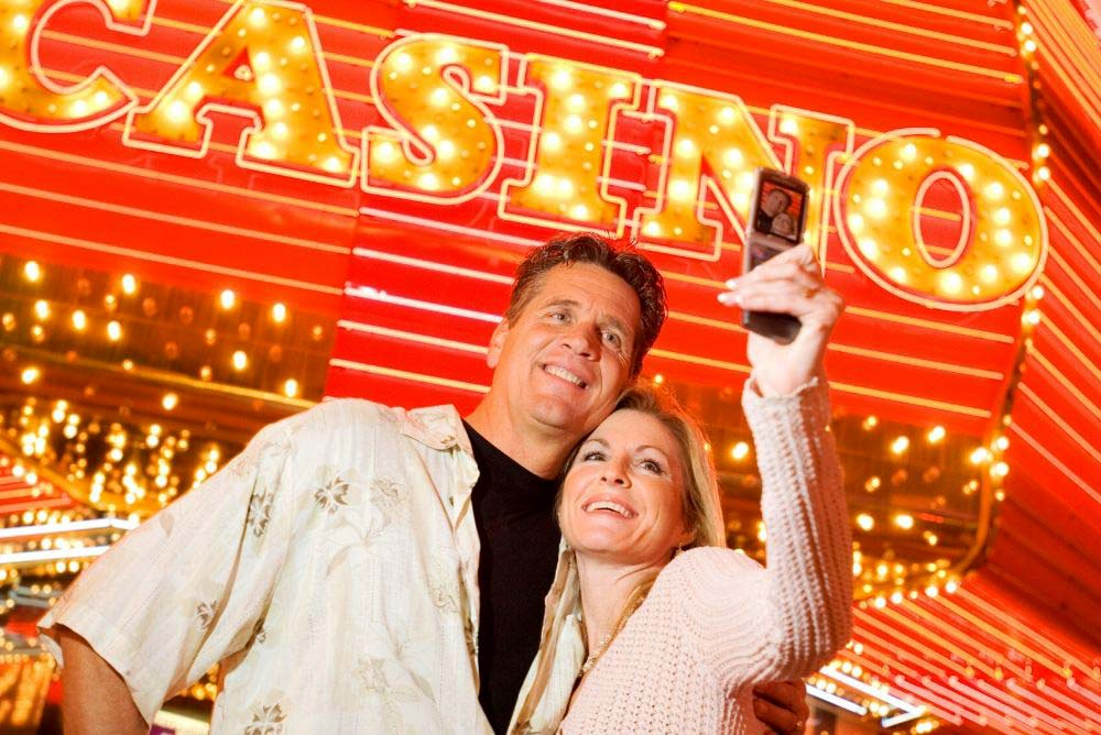 Couple taking selfie pictures at a Las Vegas casino