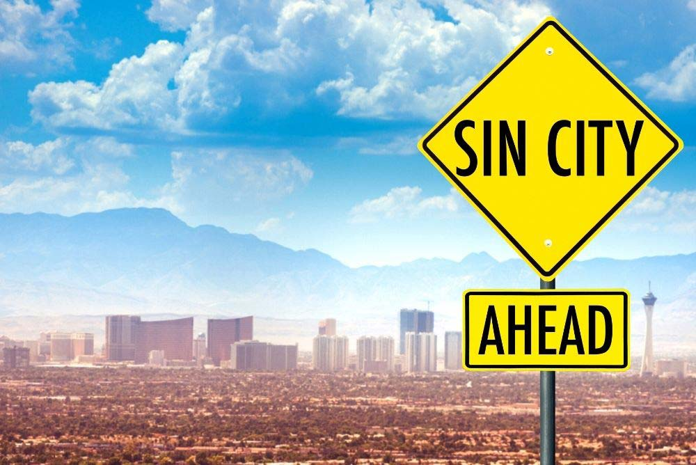 Sin City sign and Las Vegas skyline