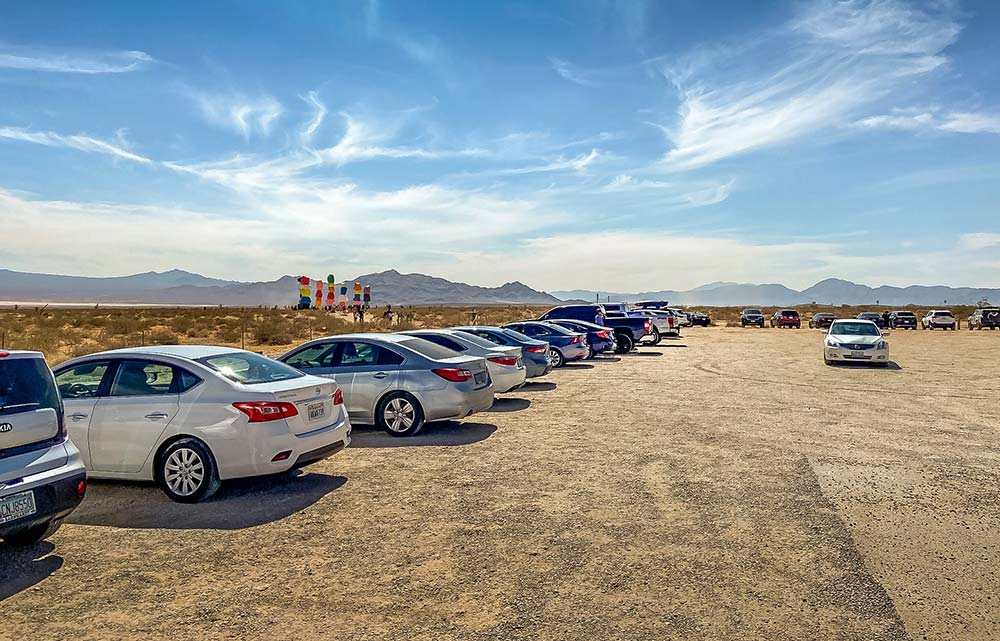 There is a large gravel parking lot at the Seven Magic Mountains near Las Vegas.
