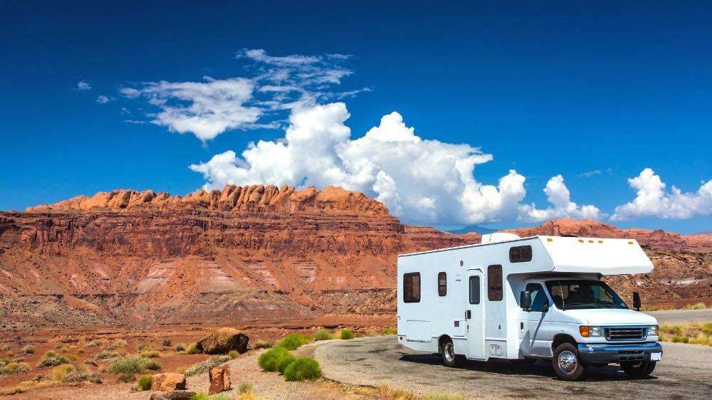Class C RV in the red rocks.