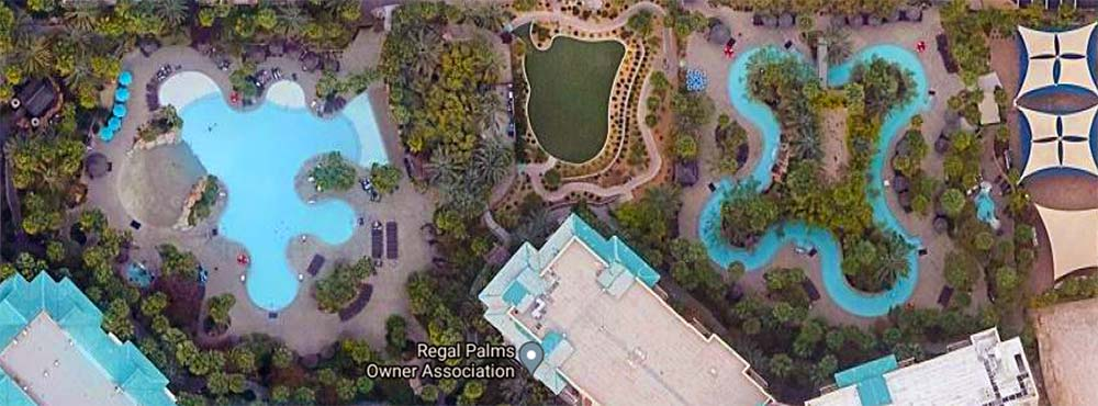 Aerial view of Tahiti Village lazy river and pool area.