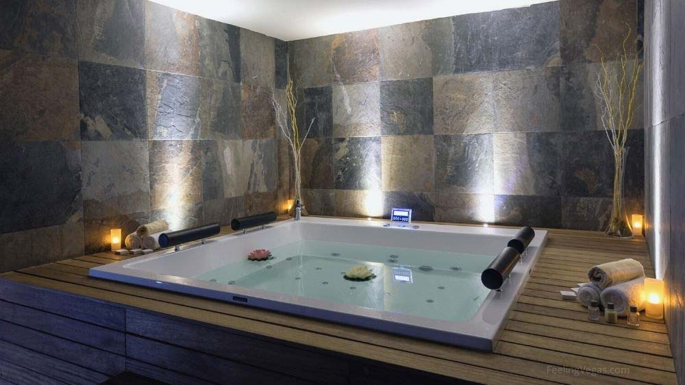 A large jacuzzi tub in a hotel room.